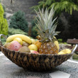 Fruit basket at garden table — Stock Photo