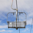 Empty chairlift on blue sky — Stock Photo