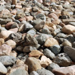 Lot of stones at beach — Stock Photo