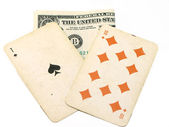 Old playing cards and dollar — Stock Photo