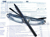 A tax form,a glasses, a pen — Stock Photo