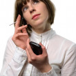 Businesswoman working with a PDA - Stock Photo