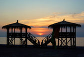 Amazing sunset behind water bungalows — Zdjęcie stockowe