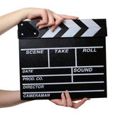 Hands with a movie clapper board close — Stok fotoğraf