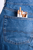 Cigarettes in the pocket of trousers. — Stock Photo