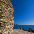 Adriatic rocks on a blue sky background — Stock Photo