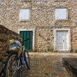 Bicycle near old stone house — Stock Photo