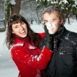 Stock Photo: Beautiful couple playing in snow