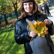 Pregnant women in autumn park — Stock fotografie