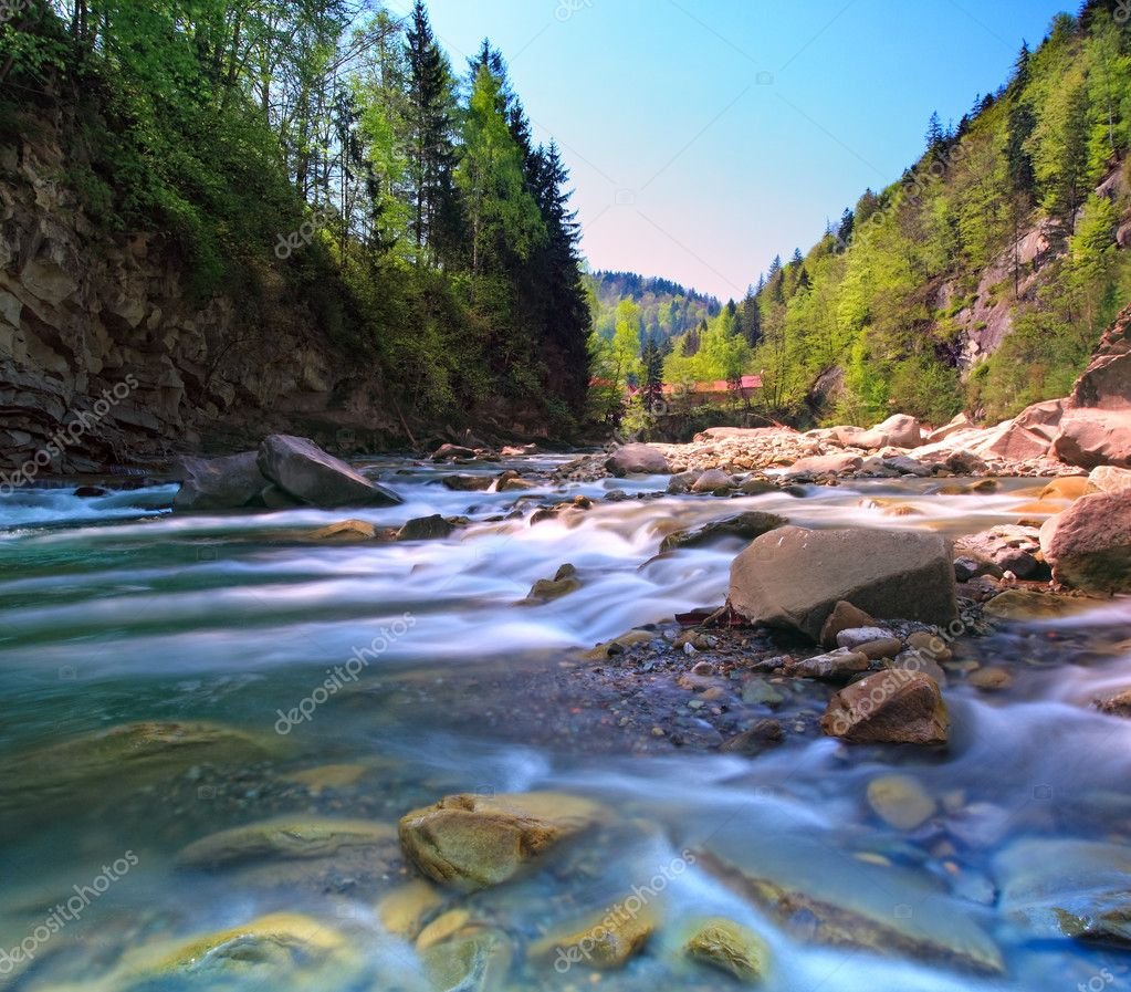 Summer shot of beautiful rapid mountain river. Shot made on long shutter speed and water is blurred. Square orientation. — Stock Photo #1750161