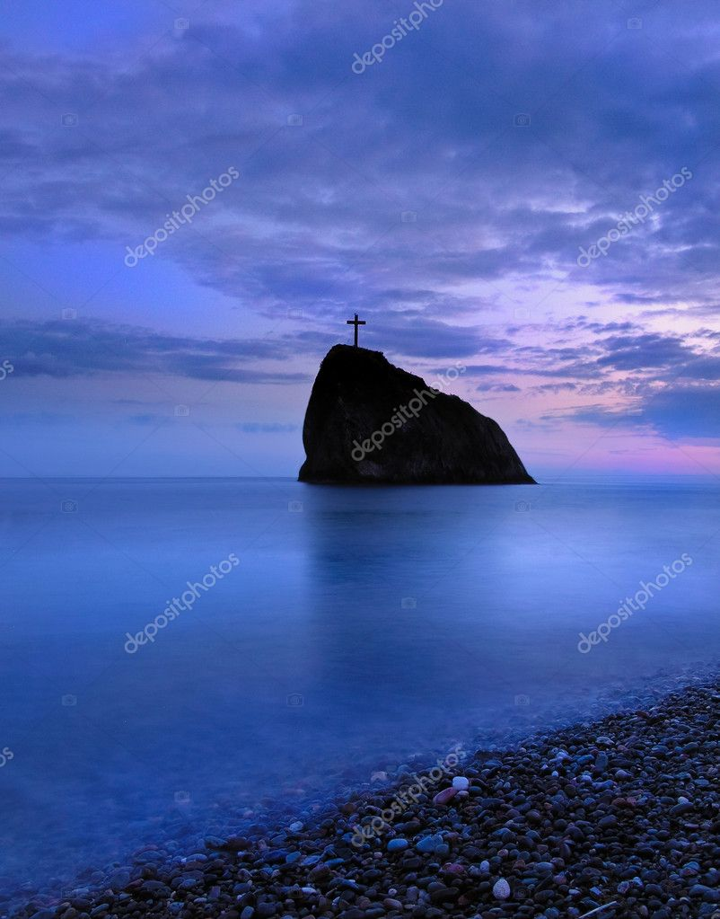 A little rock island in black sea at sunset — Stock Photo #1753318