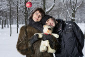 Couple playing in winter park — Stock Photo