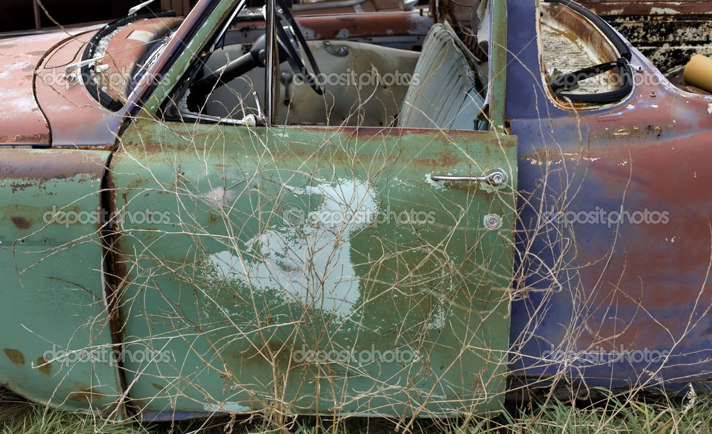 Old car body, one of many on a farm junk pile  Stock Photo #1710370