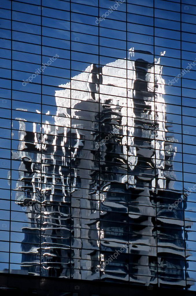 Modern office building reflected in the glass of another city building — Stock Photo #1767583