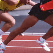 Detail views of male athletes running on synthetic running track — Stock Photo #1785439