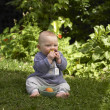 Stock Photo: Baby Boy eating fruit