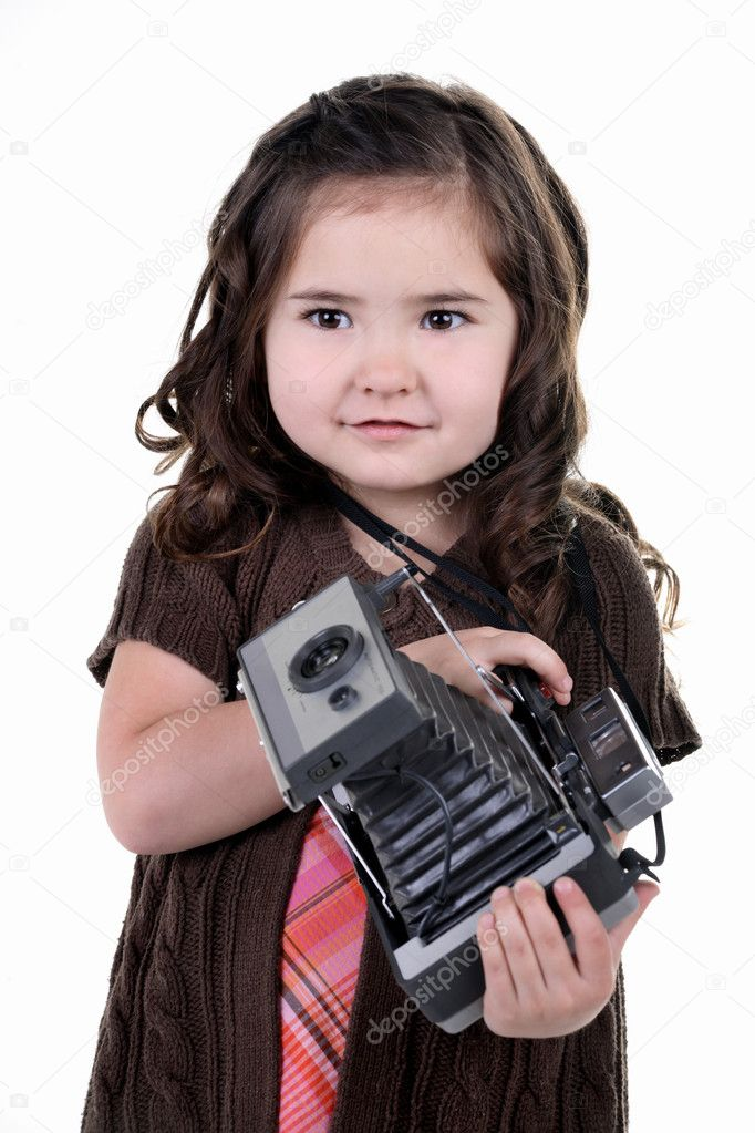 Very cute young girl holding a very old film camera and playing at being a photographer — Stock Photo #1814147