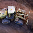 Stock Photo: Front End Loader moving ore stockpile