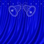 Snowflakes on blue curtain — Stock Photo