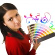 WOMAN HOLDING COLOR GUIDE - Stock Photo