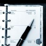 Notebook, calendar and pen — Stock Photo