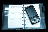 Notebook and phone — Stock Photo