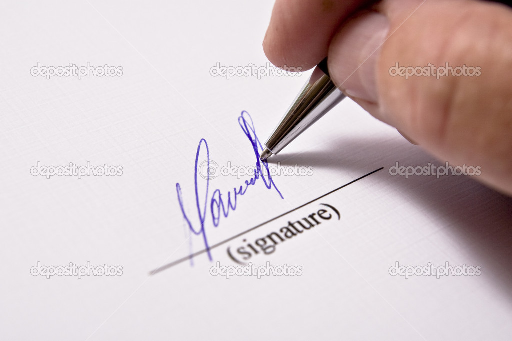 Man signing papers. The signature.  Stockfoto #1705427