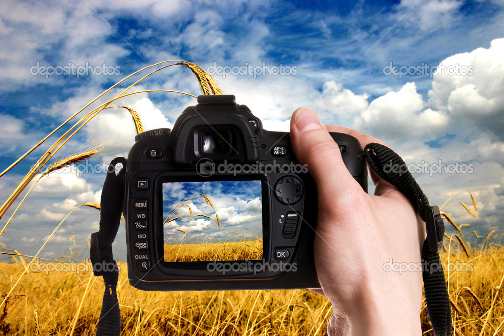 Man taking a landscape photography with a digital photo camera  Stock Photo #1725007