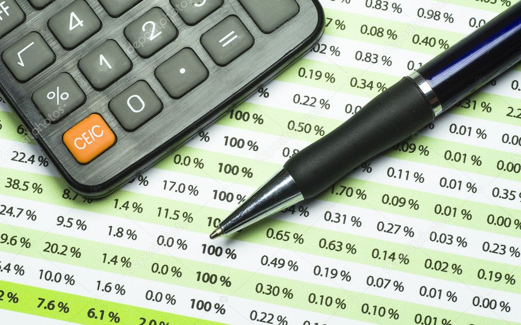 A calculator, pen, and financial statement.  Stock Photo #2013314