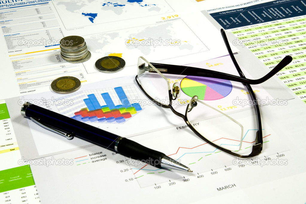 Glasses, pen and money in finance analyzing  Stock Photo #2074031