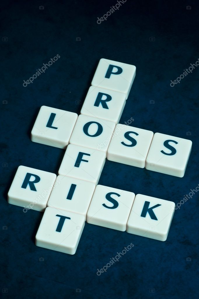 Profit, loss and risk crossword on beautiful blue backround  Stock Photo #2169188