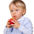 Young boy eating apple — Stock Photo