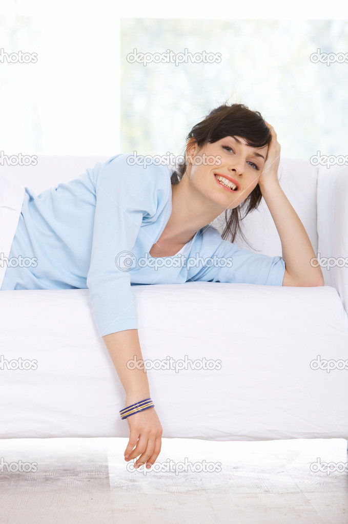 Young woman relaxing on couch in her home — Stock Photo #1929574