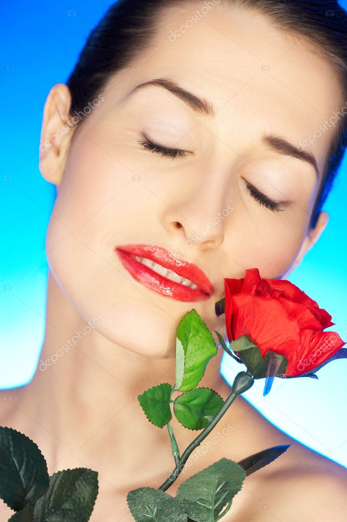 Portrait of beautiful woman with red rose — Stock Photo #1929589