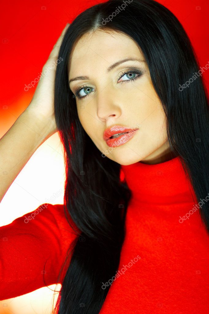 Portrait of beautiful woman wearing red sweater — Stock Photo #1929937
