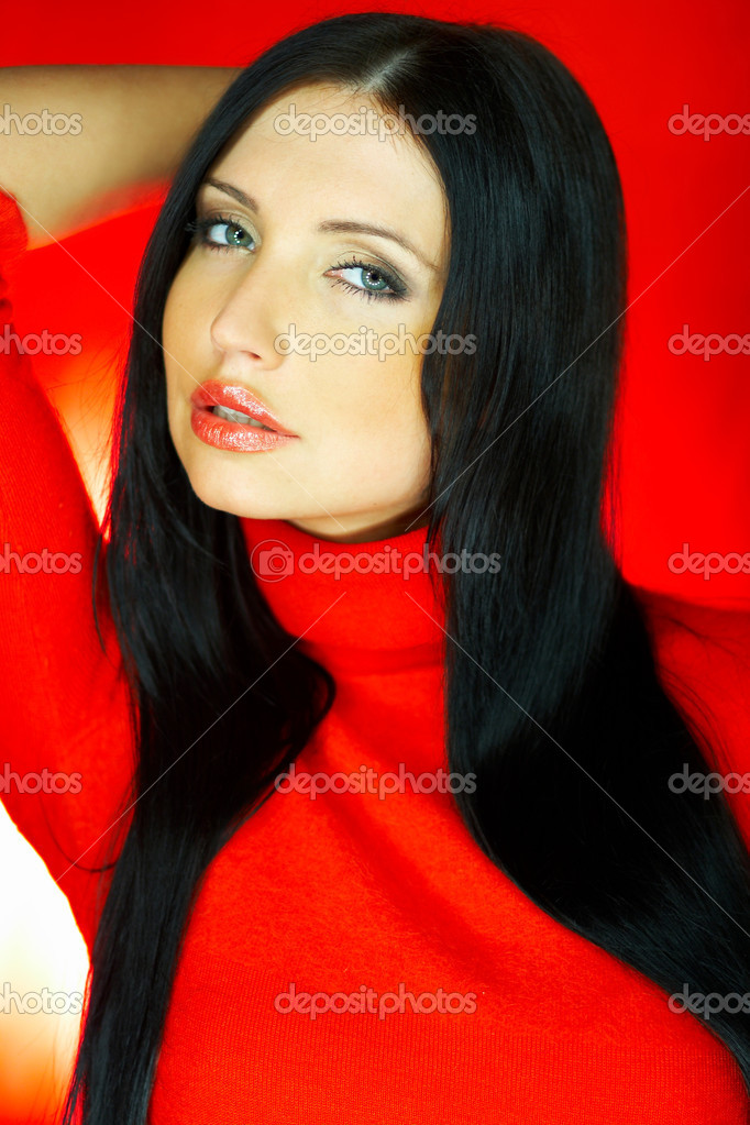 Portrait of beautiful woman wearing red sweater  Stock Photo #1929941