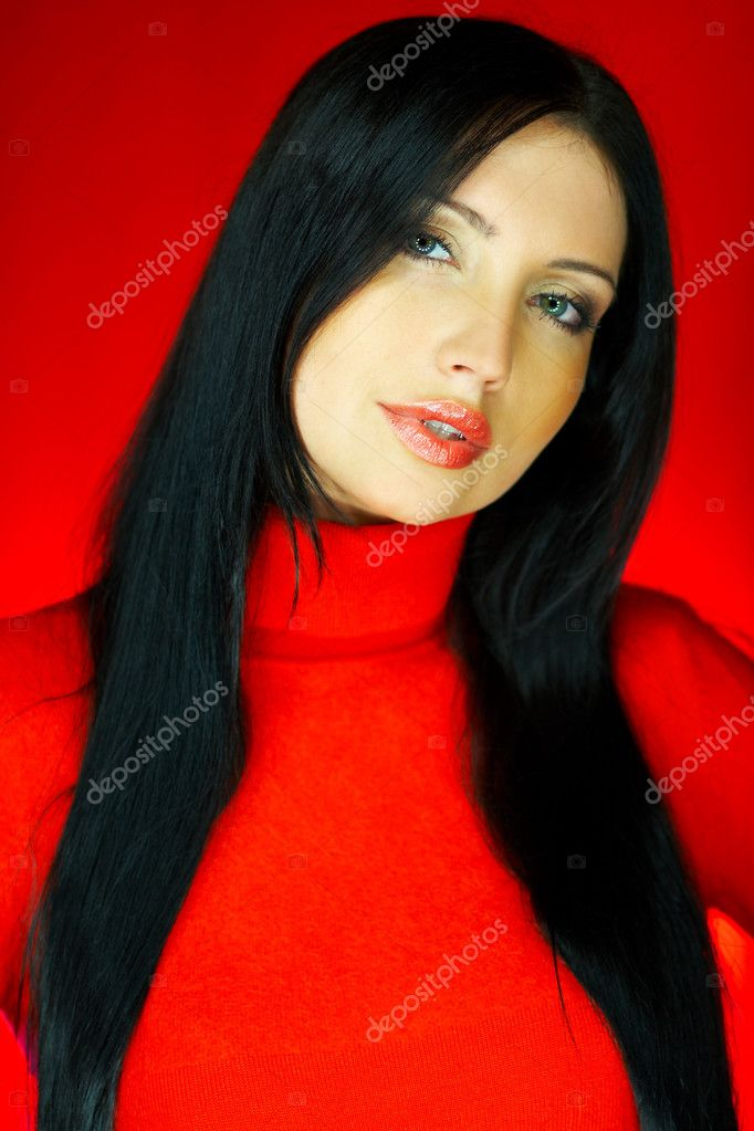 Portrait of beautiful woman wearing red sweater  Stock Photo #1929945