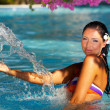 Woman in swimming pool — Foto Stock
