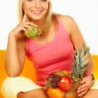Happy women with fruits — Stock Photo