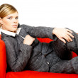 Woman on red couch — Stock Photo #1931868