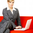 Woman on red couch — Stock Photo #1932071