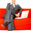 Woman on red couch — Stock Photo #1932075