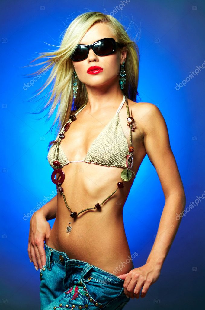 Portrait of beautiful young sexy woman on blue background  Stock Photo #1933300
