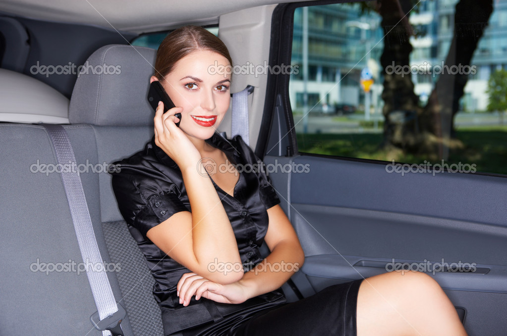 Portrait of beautiful business woman inside the limo car — Stock Photo #1933593
