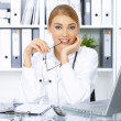 Female doctor in surgery - Stock Photo
