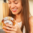 Eating cake in kitchen — Stock Photo #1949798