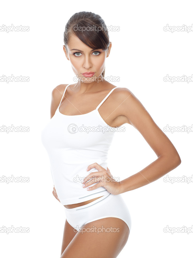 Young beautiful woman in white fitness clothing  Stock Photo #1946666
