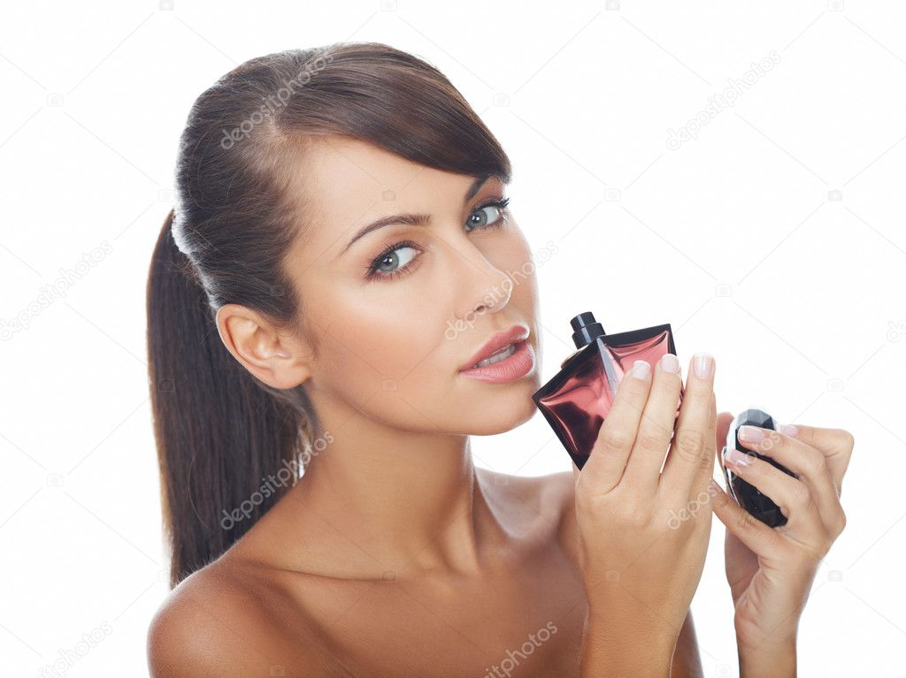 Portrait of beautiful and sexy woman with perfume bottle — Stock Photo #1946687