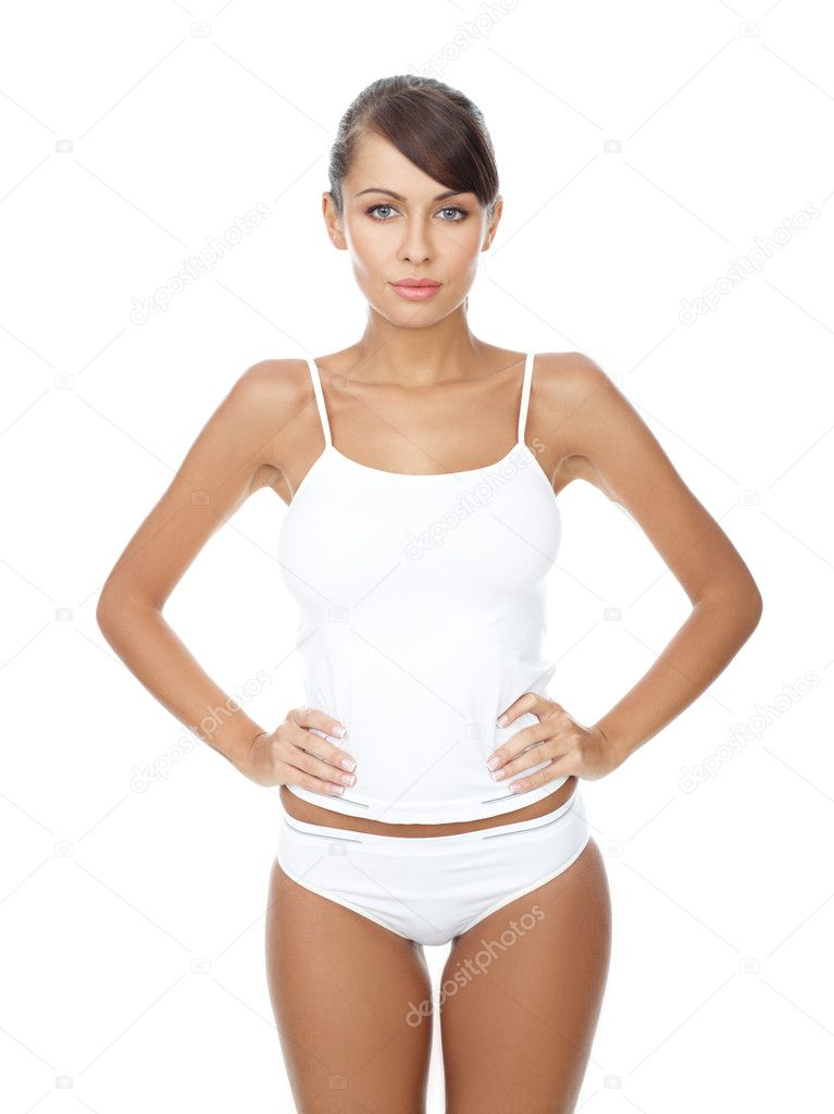 Young beautiful woman in white fitness clothing — Stock Photo #1946787
