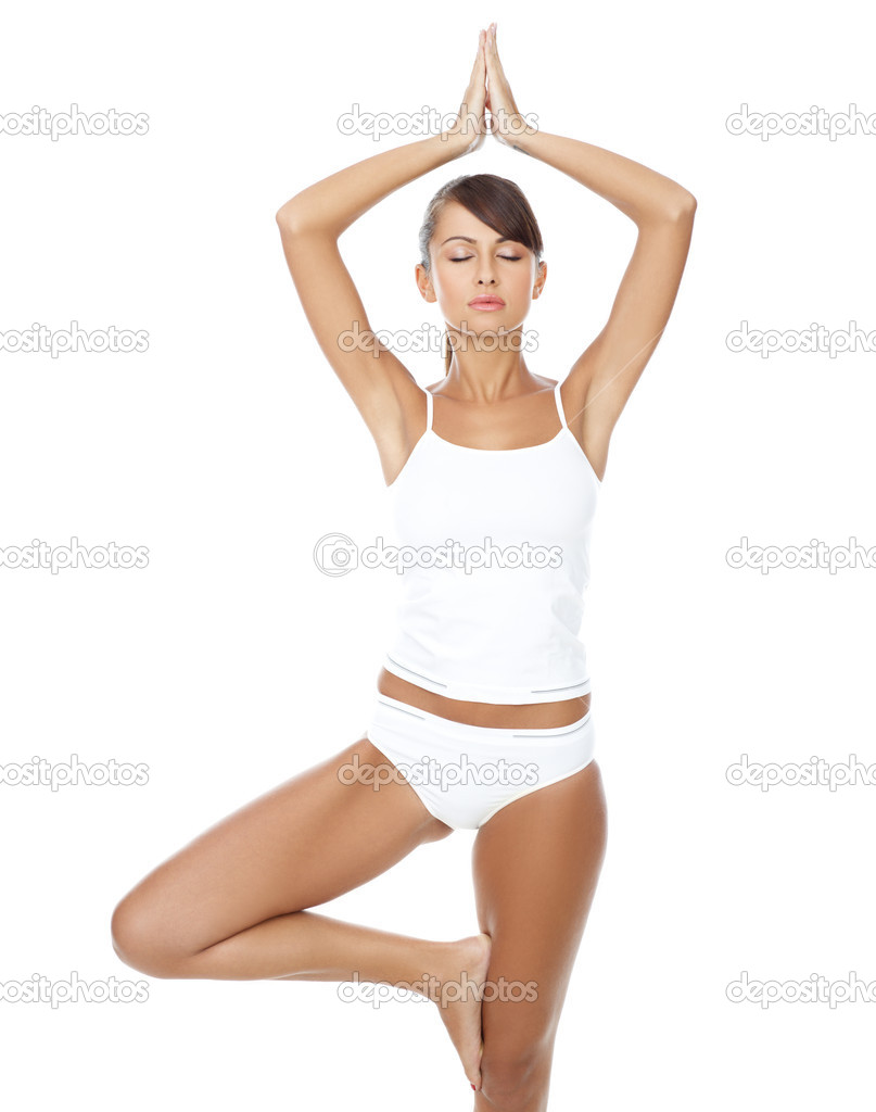 Young beautiful woman in yoga position on white — Stock Photo #1946829